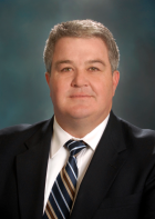 Mike is a former State Representative in the 36th District and currently serves as the Deputy Director of Facilities Management for Cook County